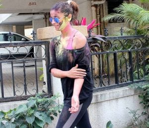 picture of a girl wearing goggles with a ponytail.