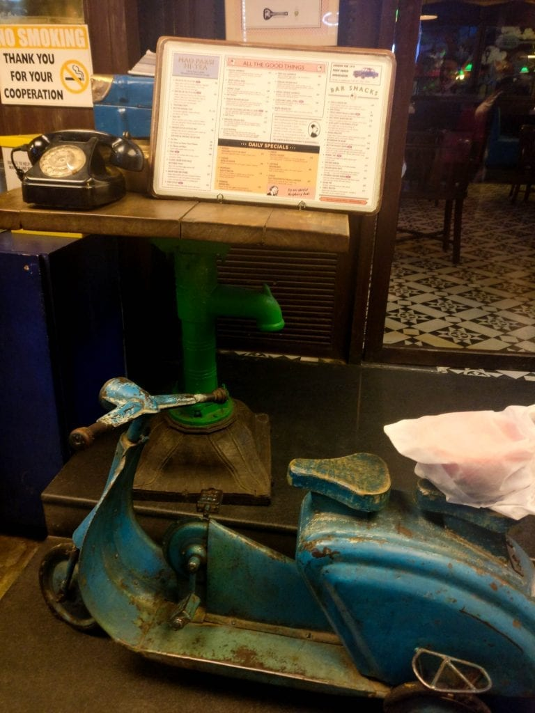 image of a small scooter and a telephone in sodabottleopenerwala