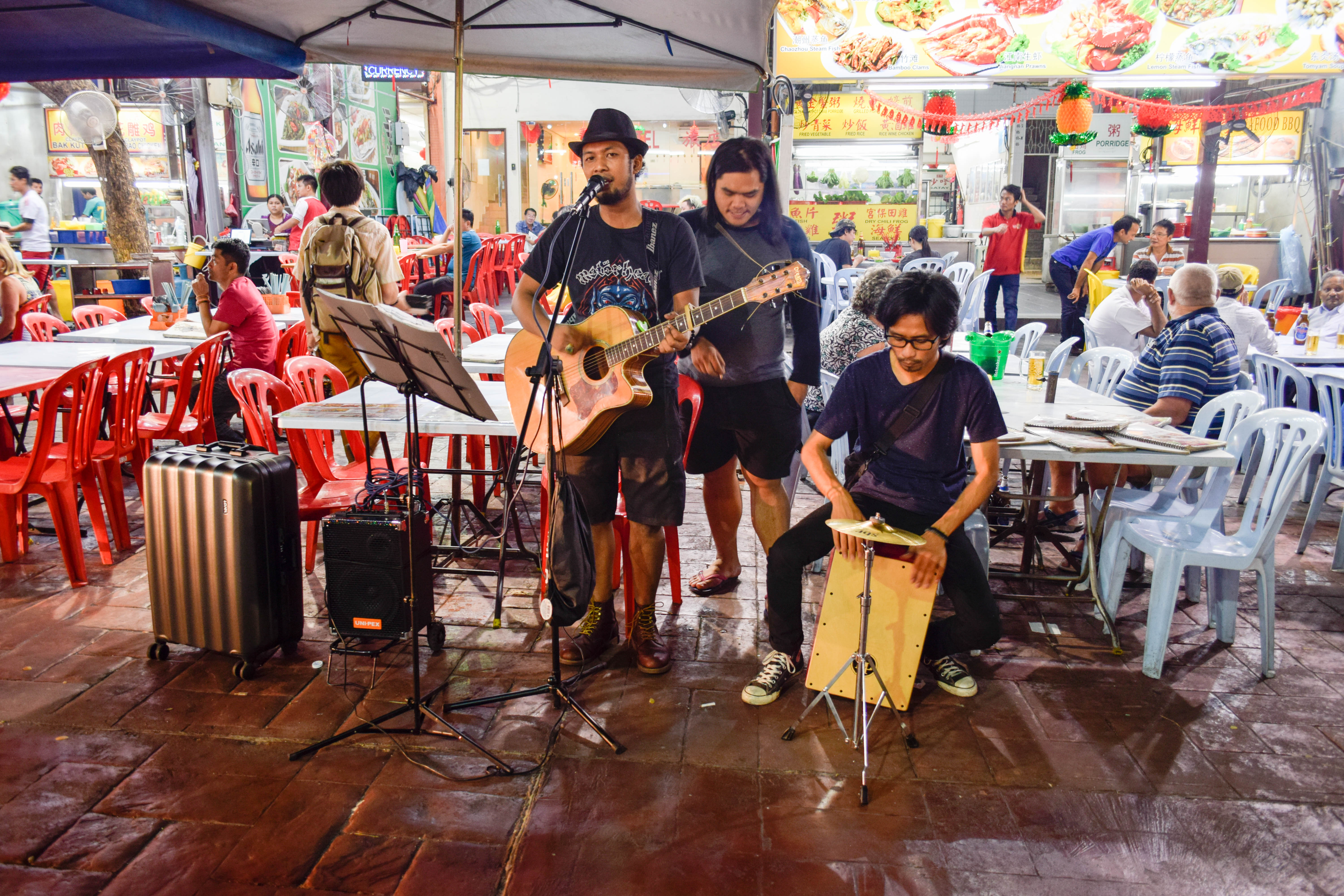 Picture of people singing in Jalan Alor
